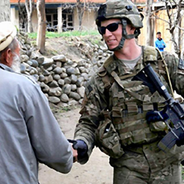 U.S. soldier shaking hands with an Afghan man