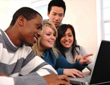 multi-ethnic high school students looking at a computer screen together