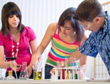 three teenage students working on a laboratory activity