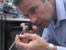 an SRI researcher examines a medical device prototype