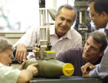 SRI researchers examine a IPDM test device.