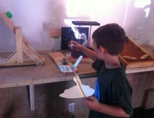 young boy student tinkering on a project