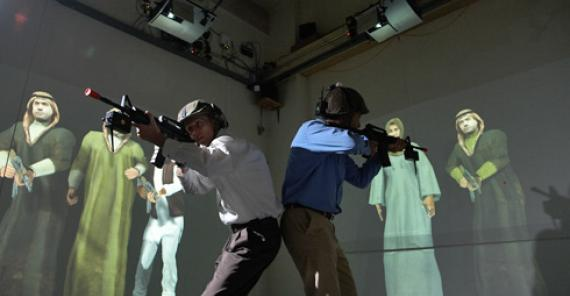 two men with fake rifles performing an excercise with projected avatars