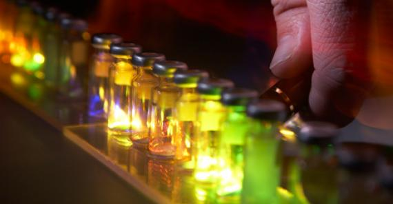 row of vials containing glowing material