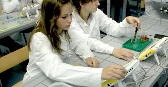 two teen students working together
