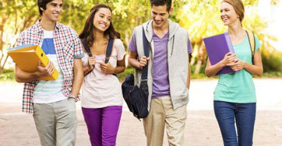 four teen students walking together