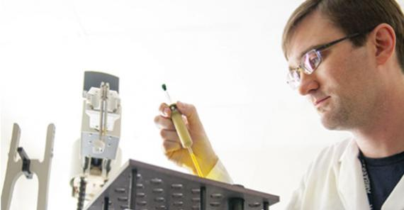 SRI researcher working with lab equipment