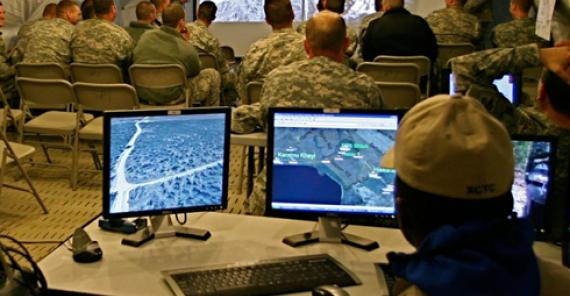 soldiers viewing arial surveillance images